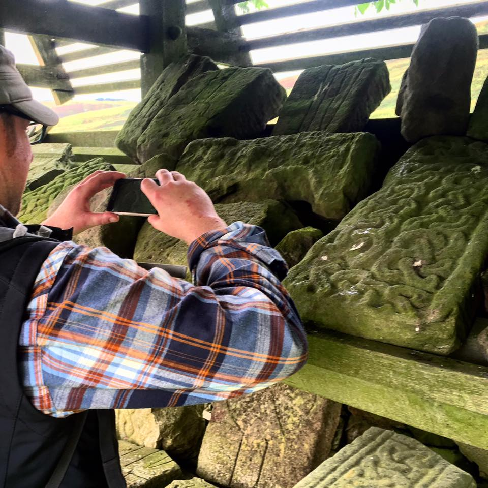 Dr David Borthwick, eco poet, capturing the centric stones collected from the old Kirk yard.